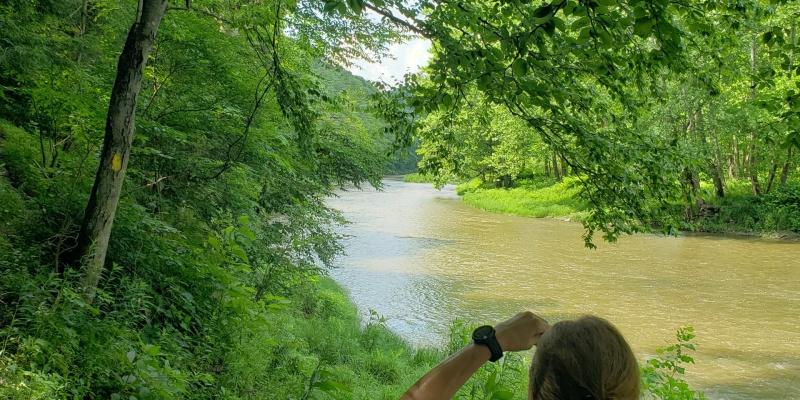 Hiker Taking Photo of Oil Creek_Scott McCray_ Summer 2020
