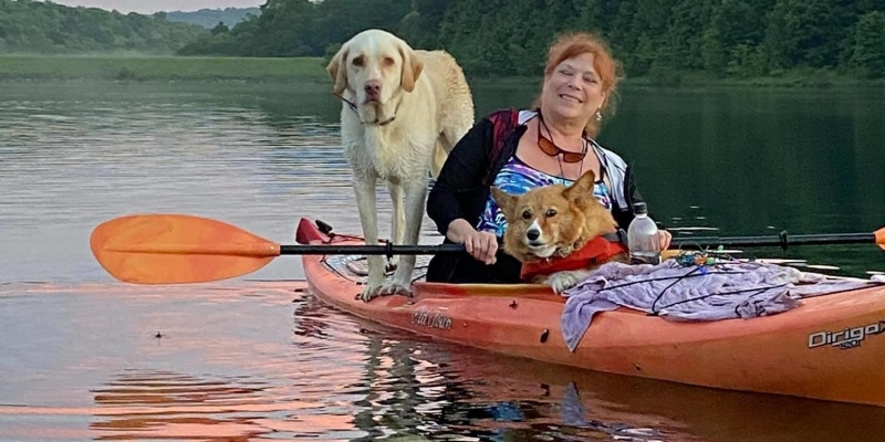 Kayaker Two Mile Run with two dogs